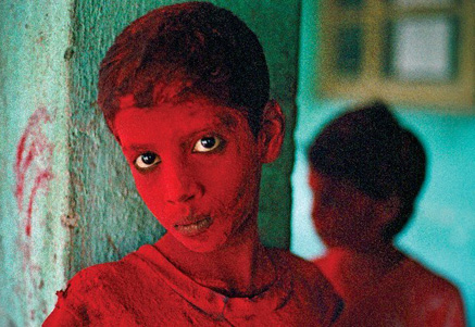 Bombay, India 1996, Red Boy by Steve  McCurry